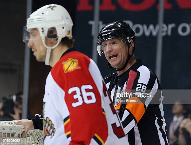 Referee Chris Lee speaks with Jussi Jokinen of the Florida Panthers against the New York Islanders in Game Six of the Eastern Conference First Round...