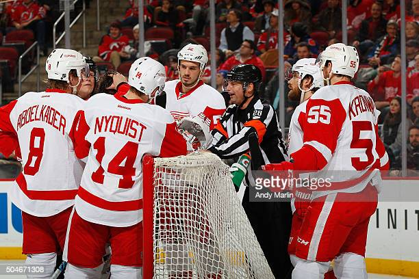 Referee Chris Lee talks with members of the Detroit Red Wings during the game against the New Jersey Devils at the Prudential Center on January 4...