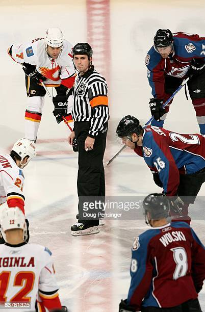 Referee Chris Rooney prepares for face off between the Calgary Flames and the Colorado Avalanche during NHL action at the Pepsi Center on November 20...