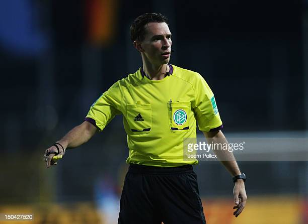 Referee Christian Bandurski gestures during the DFB Cup first round match between SV Wilhelmshaven and FC Augsburg at JadeStadion on August 17 2012...