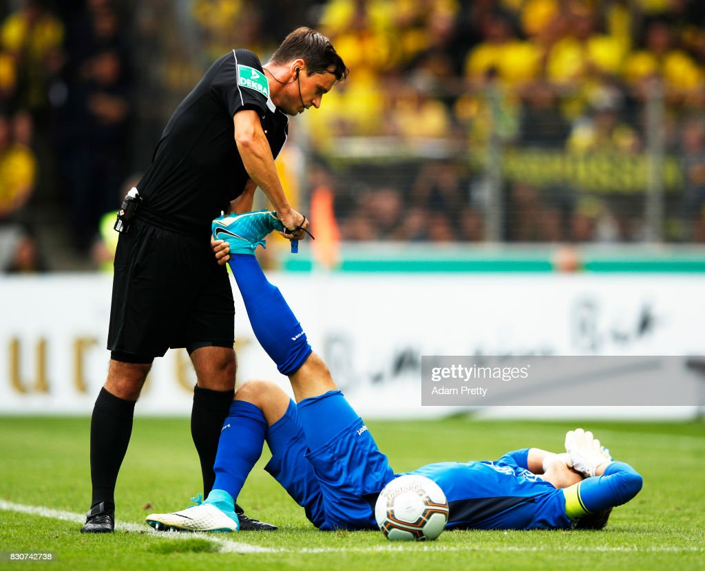 Referee Christian Dietz stretches out Dennis Klose of FC Rielasingen-Arlen during the DFB Cup match between 1. FC Rielasingen-Arlen and Borussia Dortmund at Schwarzwald-Stadion on August 12, 2017 in Freiburg im Breisgau, Germany.