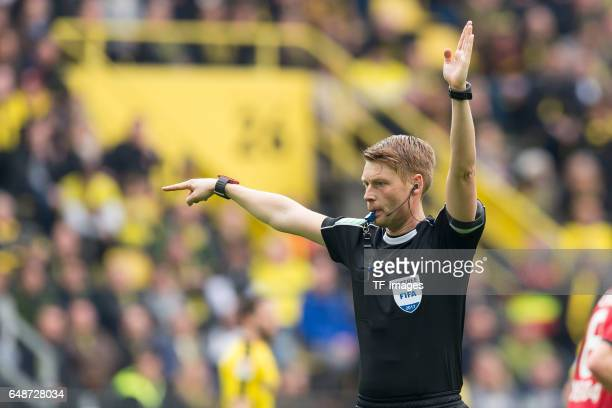 Referee Christian Dingert gestures during the Bundesliga match between Borussia Dortmund and Bayer 04 Leverkusen at Signal Iduna Park on March 4 2017...