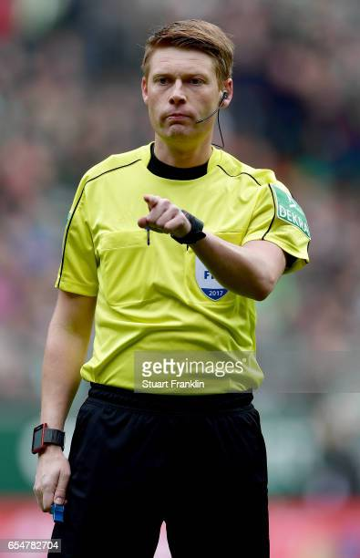 Referee Christian Dingert gestures during the Bundesliga match between Werder Bremen and RB Leipzig at Weserstadion on March 18 2017 in Bremen Germany