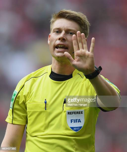 Referee Christian Dingert gestures during the Bundesliga match between Bayern Muenchen and FC Augsburg at Allianz Arena on April 1 2017 in Munich...