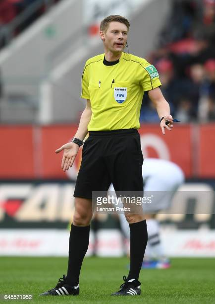 Referee Christian Dingert gestures during the Bundesliga match between FC Ingolstadt 04 and Borussia Moenchengladbach at Audi Sportpark on February...