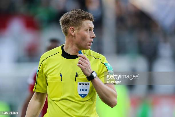 Referee Christian Dingert looks on during the Bundesliga match between FC Ingolstadt 04 and Borussia Moenchengladbach at Audi Sportpark on February...