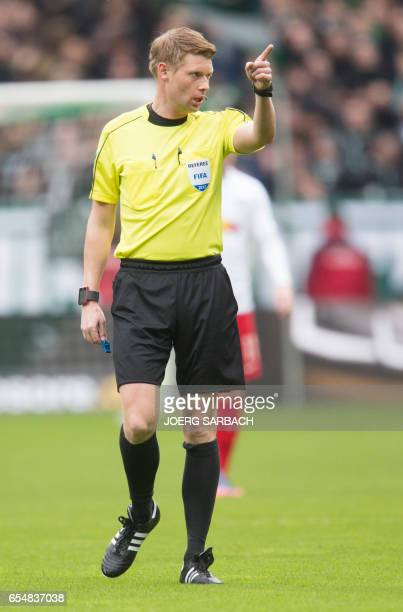 Referee Christian Dingert reacts during the German First division Bundesliga football match Werder Bremen vs RB Leipzig in Bremen northern Germany on...