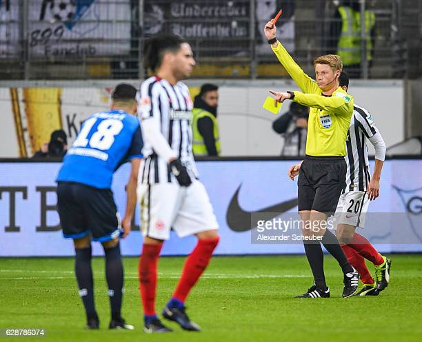 Referee Christian Dingert shows Timothy Chandler of Frankfurt the red card during the Bundesliga match between Eintracht Frankfurt and TSG 1899...