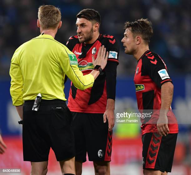Referee Christian Dingert talks with Vincenzo Grifo of Freiburg during the Bundesliga match between Hamburger SV and SC Freiburg at Volksparkstadion...