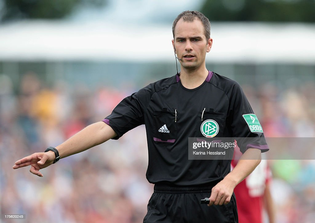 Referee Christian Leicher during the DFB Cup between SV Schott Jena and Hamburger SV at Ernst-Abbe-Sportfeld on August 04, 2013 in Jena,Germany.