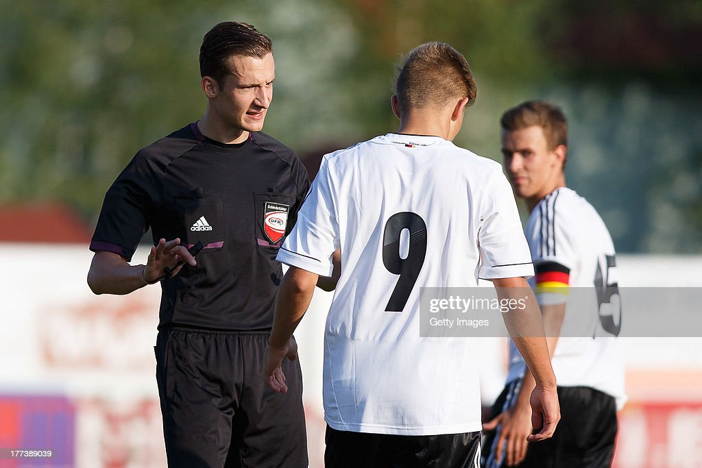 Referee Christian-Petru Ciochirca gestures to Davie Selke of Germany during the U17 Toto-Cup match between Germany and Belgium on August 21, 2013 in Gleisdorf, Austria.