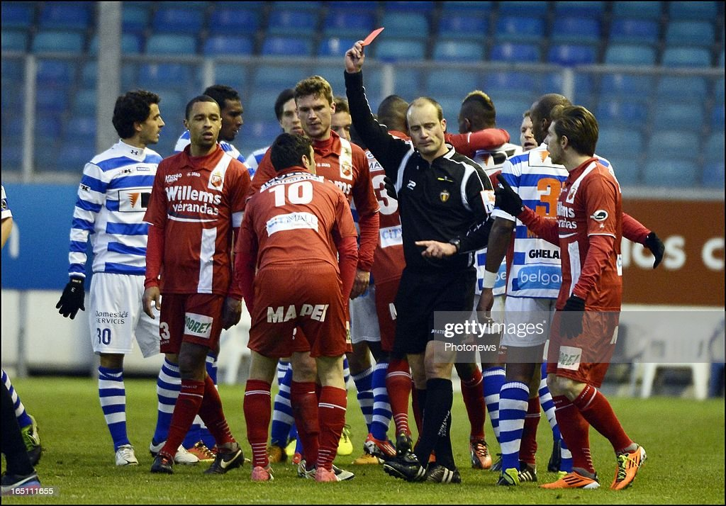 Referee Christophe Delacour shows the red card to Shlomi Arbeitman of Mons and Ervin Zukanovic of KAA Gent during theJupiler League Play-off 2 match between Kaa Gent and Raec Mons on March 30 in Gent , Belgium.