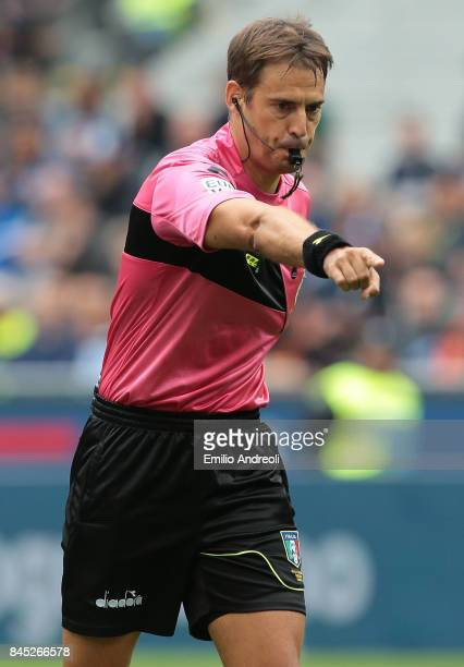 Referee Claudio Gavillucci gestures during the Serie A match between FC Internazionale and Spal at Stadio Giuseppe Meazza on September 10 2017 in...