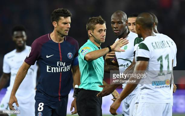 Referee Clement Turpin gestures during the French L1 football match between Paris SaintGermain and SaintEtienne on August 25 at the Parc des Princes...