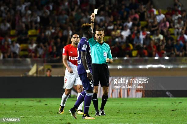 Referee Clement Turpin gives a yellow card to Jacques Francois Moubandje of Toulouse during the Ligue 1 match between AS Monaco and Toulouse at Stade...