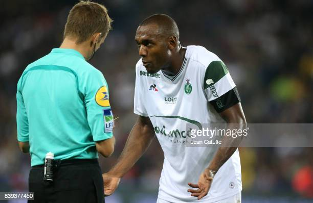 Referee Clement Turpin gives a yellow card to Kevin TheophileCatherine of SaintEtienne during the French Ligue 1 match between Paris Saint Germain...