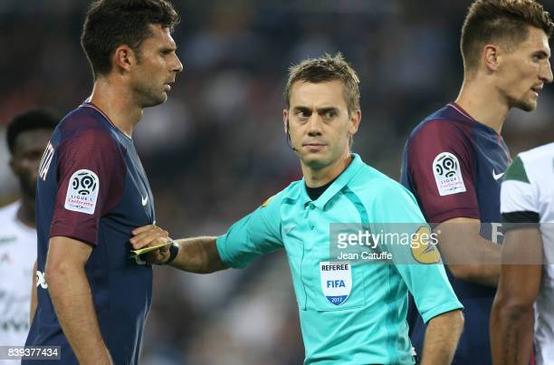 Referee Clement Turpin pushes back Thiago Motta of PSG during the French Ligue 1 match between Paris Saint Germain and AS SaintEtienne at Parc des...