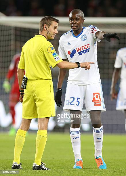 Referee Clement Turpin talks to Giannelli Imbula of OM during the French Ligue 1 match between Paris SaintGermain FC and Olympique de Marseille OM at...