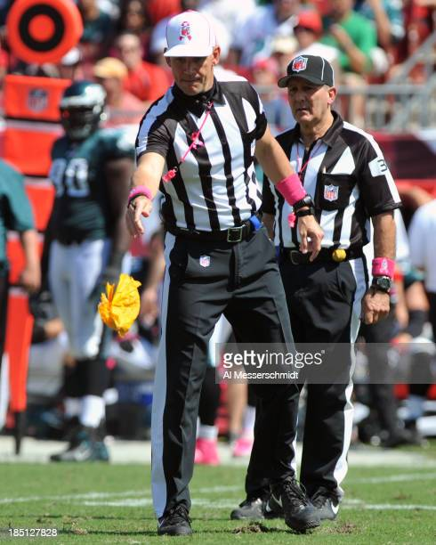 NFL referee Clete Blakeman signals a field goal as the Tampa Bay Buccaneers tosses a penalty flag during play against the Philadelphia Eagles October...