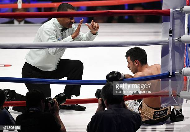 A referee counts World Boxing Council super featherweight challenger Billy Dib of Australia before declaring a technical knockout in the third round...