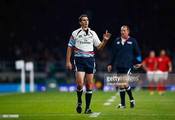 Referee Craig Joubert refers a decision to the TMO during the 2015 Rugby World Cup Pool D match between France and Italy at Twickenham Stadium on...