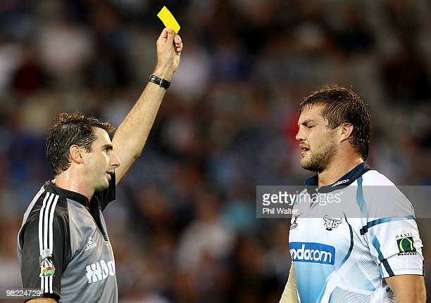 Referee Craig Joubert sends off Flip van der Merwe of the Bulls during the round eight Super 14 match between the Blues and the Bulls at Eden Park on...