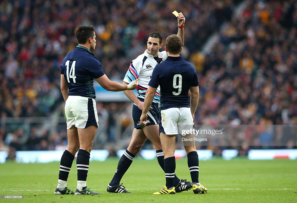 Referee Craig Joubert shows the yellow card to Sean Maitland of Scotland during the 2015 Rugby World Cup Quarter Final match between Australia and...