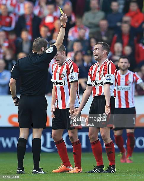 Referee Craig Pawson awards Lee Cattermole of Sunderland a yellow card during the FA Cup Quarter Final match between Hull City and Sunderland at KC...