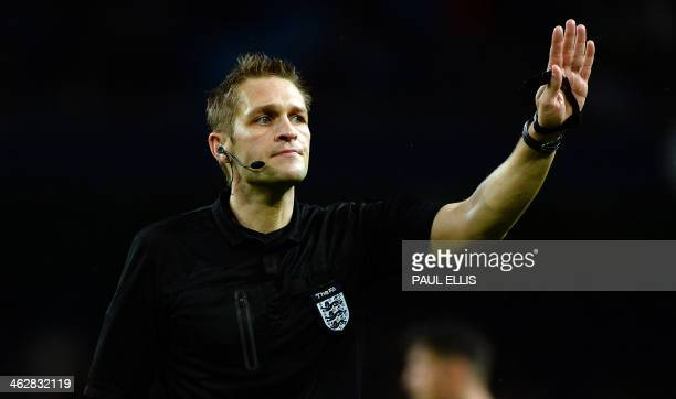 Referee Craig Pawson gestures during the English FA Cup Third Round Replay football match between Manchester City and Blackburn Rovers at the Etihad...