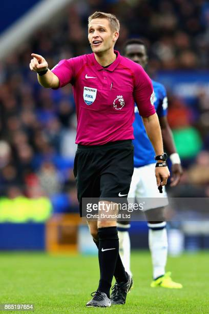 Referee Craig Pawson gestures during the Premier League match between Everton and Arsenal at Goodison Park on October 22 2017 in Liverpool England