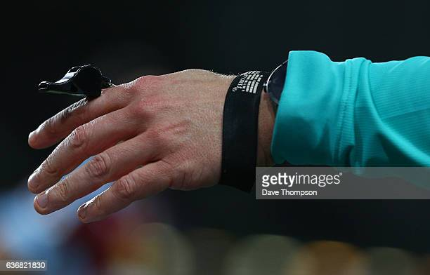 Referee Craig Pawson holds his whistle during the Premier League match between Burnley and Middlesbrough at Turf Moor on December 26 2016 in Burnley...