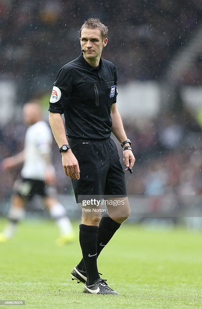 Referee Craig Pawson in action during the Sky Bet Championship Semi Final Second Leg between Derby County and Brighton & Hove Albion at iPro Stadium on May 11, 2014 in Derby, England.