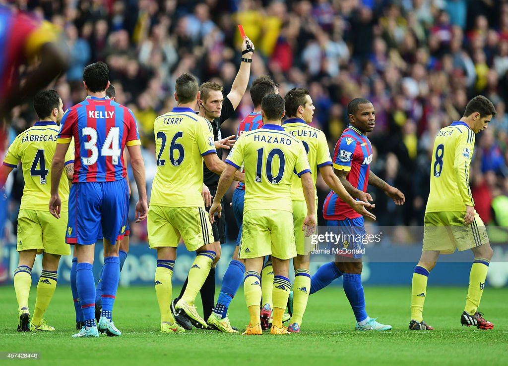 Referee Craig Pawson shows a red card to Cesar Azpilicueta of Chelsea (3R) and is sent off during the Barclays Premier League match between Crystal Palace and Chelsea at Selhurst Park on October 18, 2014 in London, England.