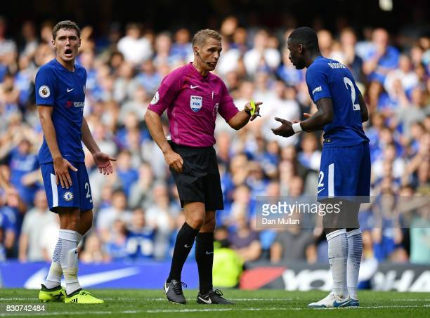 Referee Craig Pawson shows Antonio Rudiger of Chelsea a yellow card during the Premier League match between Chelsea and Burnley at Stamford Bridge on...