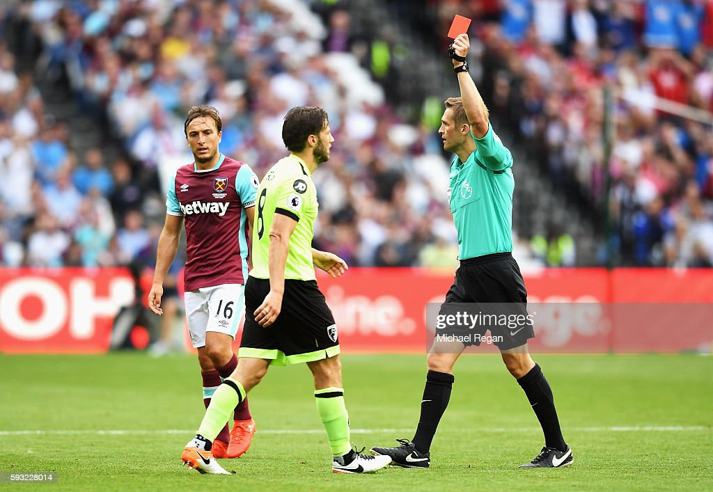 Referee Craig Pawson shows the red card to Harry Arter of AFC Bournemouth during the Premier League match between West Ham United and AFC Bournemouth at London Stadium on August 21, 2016 in London, England.