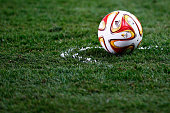 Referee Craig Thomson uses the vanishing spray also known as vanishing foam out to mark a line for the ball during the UEFA Europa League Round of 16...