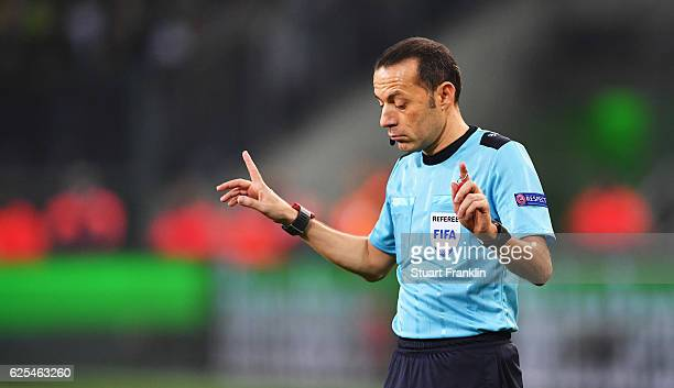 Referee Cueneyt Cakir gestures during the UEFA Champions League match between VfL Borussia Moenchengladbach and Manchester City FC at BorussiaPark on...