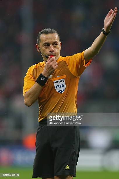 Referee Cueneyt Cakir reacts during the UEFA Champions League Group E match between FC Bayern Munchen and AS Roma at Allianz Arena on November 5 2014...