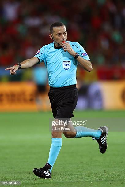 Referee Cuneyt Cakir brows a whistle during the UEFA EURO 2016 Group F match between Portugal and Iceland at Stade GeoffroyGuichard on June 14 2016...
