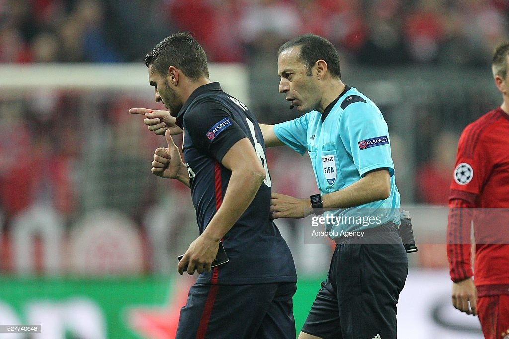 Referee Cuneyt Cakir (R) conducts the UEFA Champions League semifinal second leg soccer match between FC Bayern Munich and Atletico Madrid at the Allianz Arena in Munich, Germany on May 3, 2016.