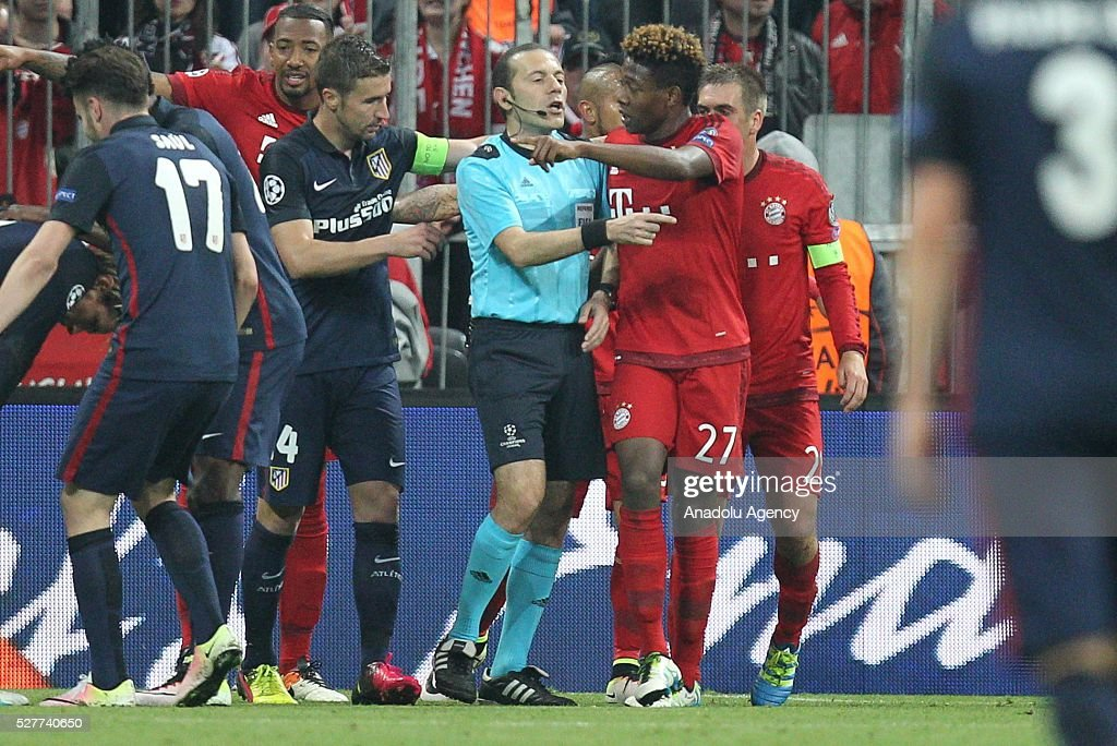 Referee Cuneyt Cakir conducts the UEFA Champions League semifinal second leg soccer match between FC Bayern Munich and Atletico Madrid at the Allianz Arena in Munich, Germany on May 3, 2016.