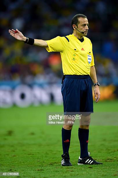 Referee Cuneyt Cakir gestures during the 2014 FIFA World Cup Brazil Group H match between Algeria and Russia at Arena da Baixada on June 26 2014 in...