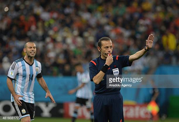 Referee Cuneyt Cakir gestures during the 2014 FIFA World Cup Brazil Semi Final match between the Netherlands and Argentina at Arena de Sao Paulo on...