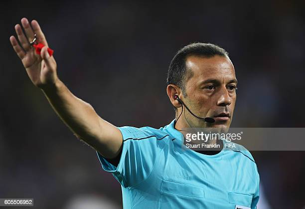 Referee Cuneyt Cakir gestures during the Olympic Men's Football match between Argentina and Algeria at Olympic Stadium on August 7 2016 in Rio de...
