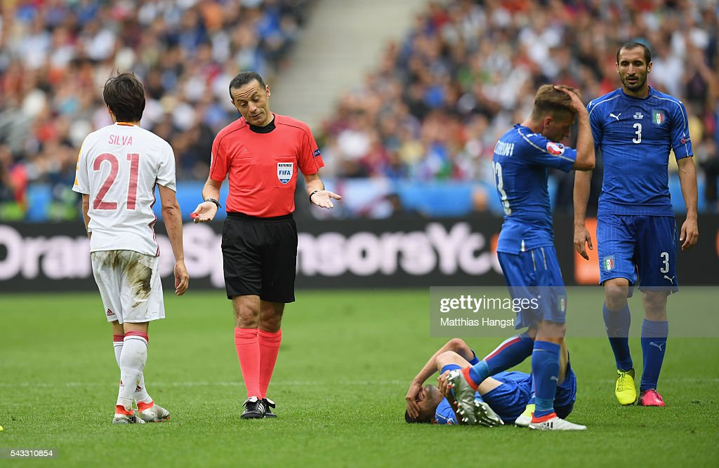 Referee Cuneyt Cakir gestures during the UEFA EURO 2016 round of 16 match between Italy and Spain at Stade de France on June 27, 2016 in Paris, France.