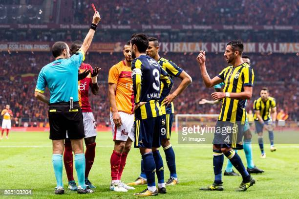 referee Cuneyt Cakir give a red card to Younes Belhanda of Galatasaray SK during the Turkish Spor Toto Super Lig football match between Galatasaray...