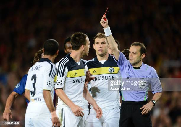 Referee Cuneyt Cakir gives John Terry of Chelsea a direct red card during the UEFA Champions League Semi Final second leg match between FC Barcelona...