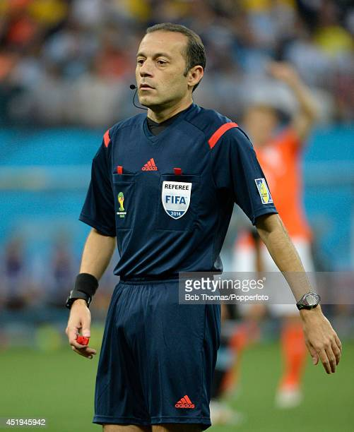 Referee Cuneyt Cakir in action during the 2014 FIFA World Cup Brazil Semi Final match between Netherlands and Argentina at Arena de Sao Paulo on July...