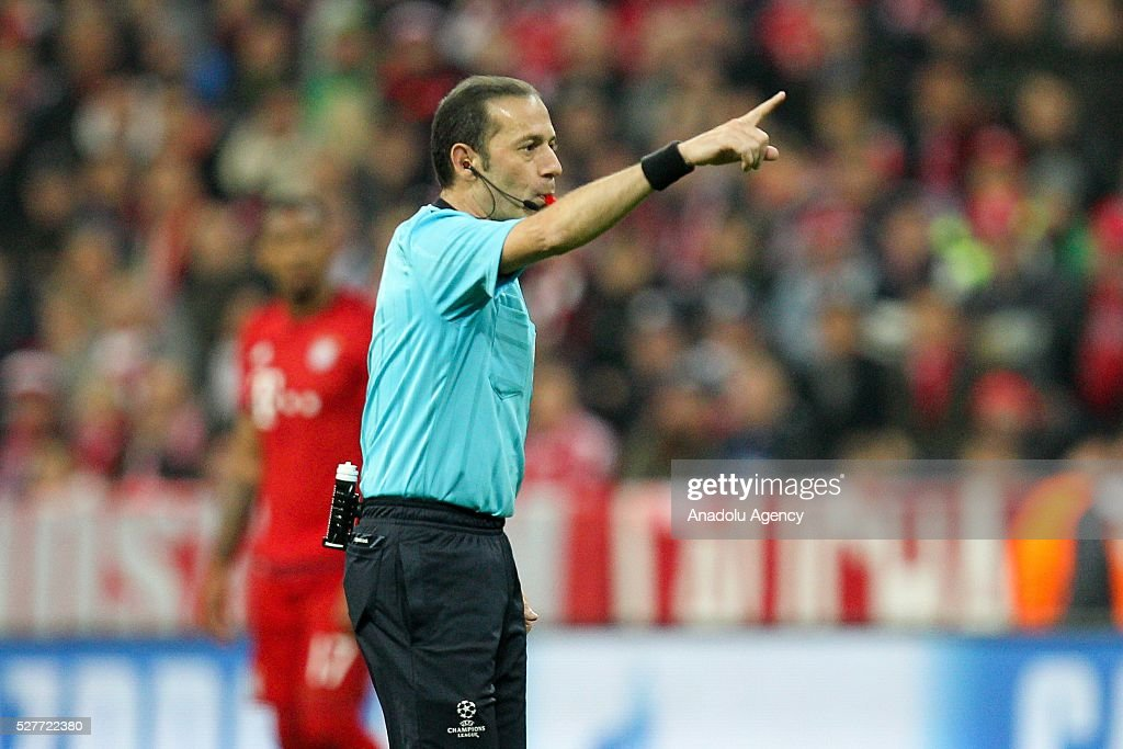 Referee Cuneyt Cakir is seen during the UEFA Champions League semifinal second leg soccer match between FC Bayern Munich and Atletico Madrid at the Allianz Arena in Munich, Germany on May 3, 2016.
