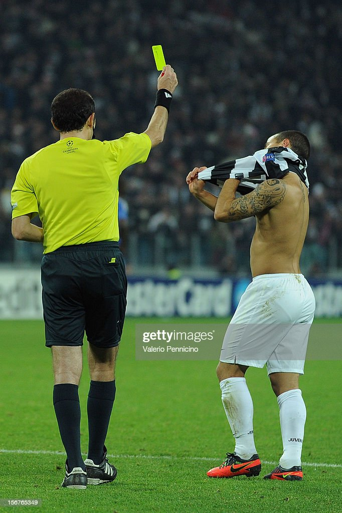Referee Cuneyt Cakir issues <a gi-track='captionPersonalityLinkClicked' href=/galleries/search?phrase=Sebastian+Giovinco&family=editorial&specificpeople=4284715 ng-click='$event.stopPropagation()'>Sebastian Giovinco</a> of Juventus FC with a yellow card for removing his shirt whilst celebrating during the UEFA Champions League Group E match between Juventus and Chelsea FC at Juventus Arena on November 20, 2012 in Turin, Italy.